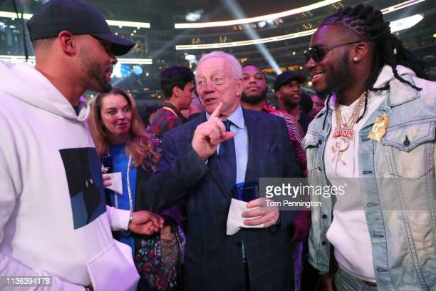 Dallas Cowboys owner Jerry Jones talks with Dallas Cowboys quarterback Dak Prescott and defensive end DeMarcus Lawrence before Errol Spence Jr takes...