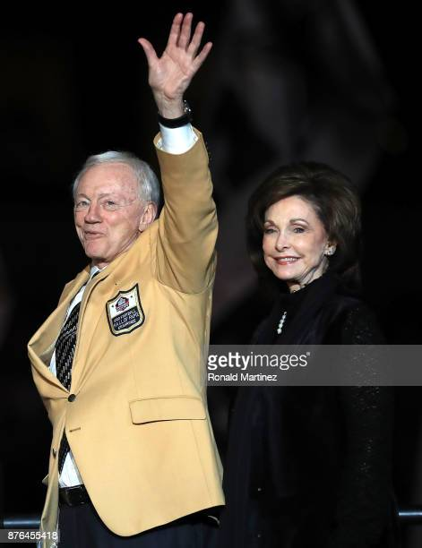 Dallas Cowboys owner Jerry Jones waves to the crowd as he and his wife Gene take the stage before the Pro Football Hall of Fame ring ceremony during...