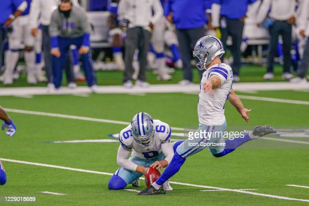 Dallas Cowboys Place Kicker Greg Zuerlein kicks the game winning field goal with 3 seconds left to play in the NFL game between the New York Giants...