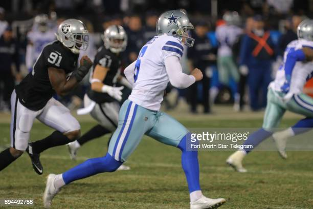 Dallas Cowboys punter Chris Jones fakes a punt and gets a crucial first down in the third quarter against the Oakland Raiders on Sunday Dec 17 2017...