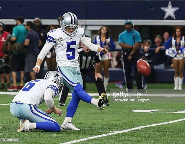 0f71928db Dallas Cowboys punter Chris Jones holds for kicker Dan Bailey as he... News  Photo