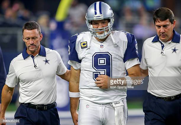 Dallas Cowboys QB Tony Romo comes off the field after an injury during the NFL Thanksgiving game between the Carolina Panthers and the Dallas Cowboys...