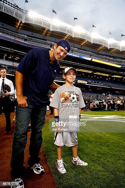 Dallas Cowboys Quarterback and Starter Spokesperson Tony Romo and Ben Grant 10 year old boy from Starlight Foundation attend NY Yankee batting...