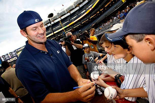 Dallas Cowboys Quarterback and Starter Spokesperson Tony Romo signes autographs at NY Yankee batting practice at Yankee Stadium on June 30 2009 in...