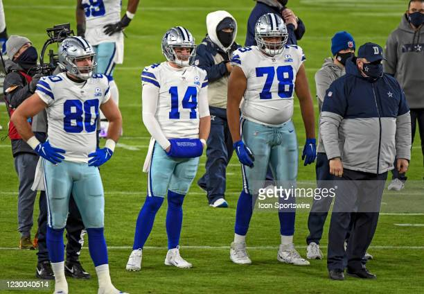 Dallas Cowboys quarterback Andy Dalton , tight end Blake Bell , offensive tackle Terence Steele stand with Dallas Head Coach Mike McCarthy as they...
