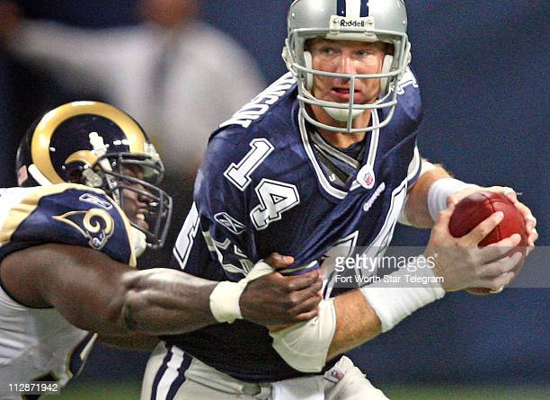 Dallas Cowboys quarterback Brad Johnson is chased down and sacked by St Louis Rams defensive end James Hall in the third quarter The Rams defeated...
