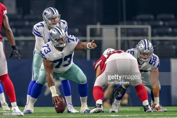 Dallas Cowboys quarterback Cooper Rush lines up behind center Joe Looney during the preseason football game between the Dallas Cowboys and Arizona...