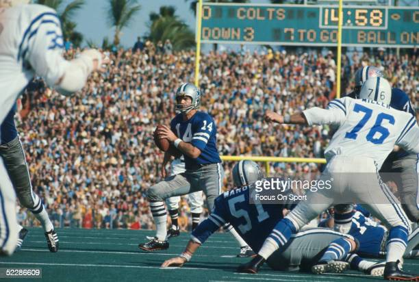 Dallas Cowboys' quarterback Craig Morton runs with the ball and looks for a receiver while under pressure from the Baltimore Colts during Super Bowl...