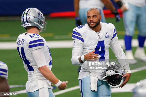 Dallas Cowboys Quarterback Dak Prescott and Andy Dalton talk prior to the NFL game between the New York Giants and Dallas Cowboys on October 11, 2020...