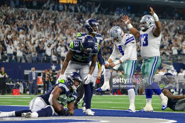 Dallas Cowboys quarterback Dak Prescott and center Joe Looney celebrate during the NFC wildcard playoff game between the Seattle Seahawks and Dallas...