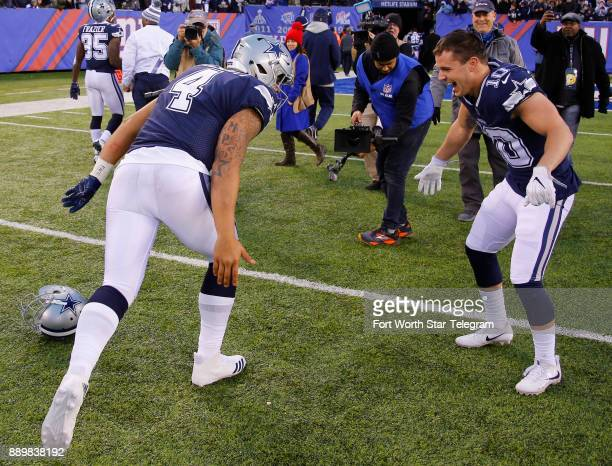Dallas Cowboys quarterback Dak Prescott and kick returner Ryan Switzer celebrate after the Cowboys beat the New York Giants 3010 on Sunday Dec 10...