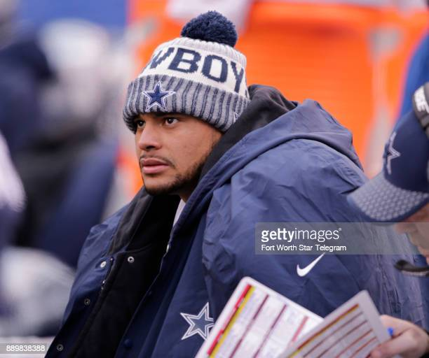 Dallas Cowboys quarterback Dak Prescott bundled up on the bench late in the first half during a long New York Giants possession on Sunday Dec 10 2017...
