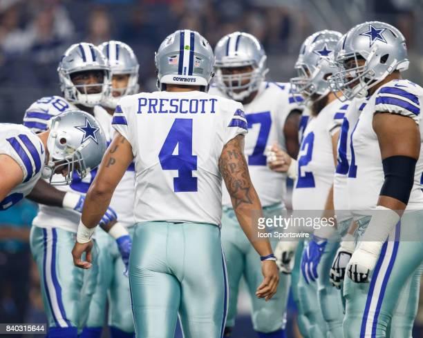 Dallas Cowboys quarterback Dak Prescott calls a play in the huddle during the NFL preseason game between the Dallas Cowboys and Oakland Raiders on...