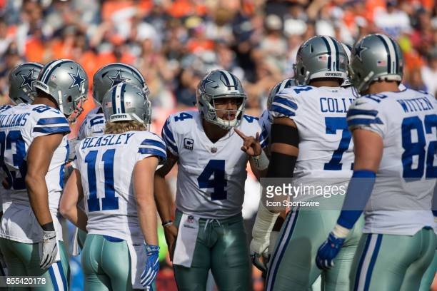 Dallas Cowboys quarterback Dak Prescott calls the play in the huddle during a game between the Denver Broncos and the Dallas Cowboys on September 17...