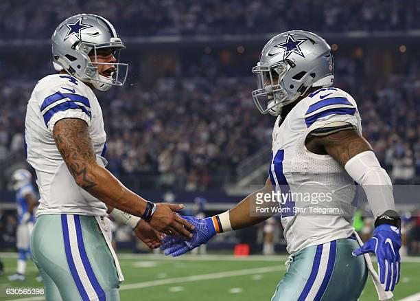 Dallas Cowboys quarterback Dak Prescott celebrates the touchdown run by Dallas Cowboys running back Ezekiel Elliott in the first quarter as the...