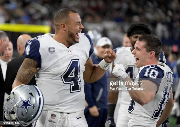 Dallas Cowboys quarterback Dak Prescott celebrates with wide receiver Ryan Switzer on Switzer's punt return for a touchdown during the second quarter...