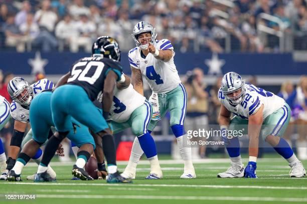 Dallas Cowboys quarterback Dak Prescott directs blocking during the game between the Jacksonville Jaguars and Dallas Cowboys on October 14 2018 at...