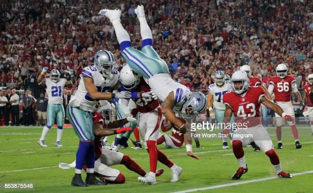 Dallas Cowboys quarterback Dak Prescott dives for a touchdown in the second quarter as the Dallas Cowboys play the Arizona Cardinals in University of...