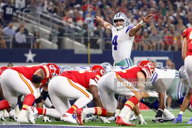 Dallas Cowboys quarterback Dak Prescott gestures to the crowd prior to beginning his cadence during the NFL game between the Kansas City Chiefs and...