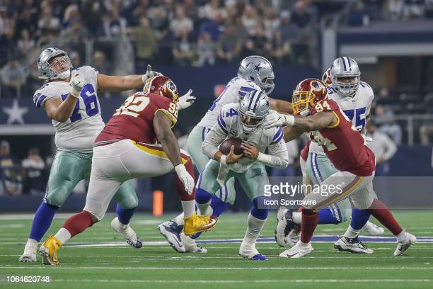Dallas Cowboys quarterback Dak Prescott gets sacked by Washington Redskins outside linebacker Preston Smith and defensive end Jonathan Allen during...