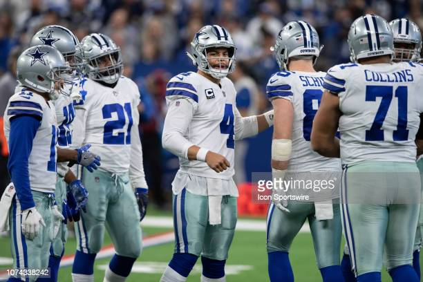 Dallas Cowboys quarterback Dak Prescott huddles the offense on the field during the NFL game between the Indianapolis Colts and Dallas Cowboys on...