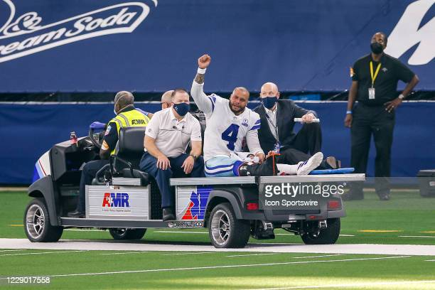 Dallas Cowboys Quarterback Dak Prescott is carted off the field after suffering a leg injury during the NFL game between the New York Giants and...