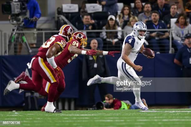 Dallas Cowboys quarterback Dak Prescott is chased by Washington Redskins linebacker Preston Smith and linebacker Zach Brown during the Thursday Night...