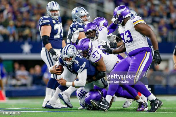 Dallas Cowboys Quarterback Dak Prescott is hit by Minnesota Vikings Defensive End Everson Griffen and Nose Tackle Armon Watts during the game between...