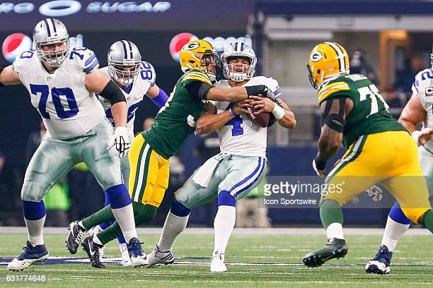 Dallas Cowboys quarterback Dak Prescott is sacked by Green Bay Packers strong safety Micah Hyde during the NFC Divisional Playoff game between the...