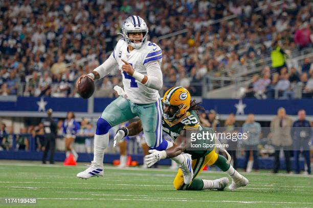Dallas Cowboys quarterback Dak Prescott is sacked from behind by Green Bay Packers outside linebacker Za'Darius Smith during the game between the...