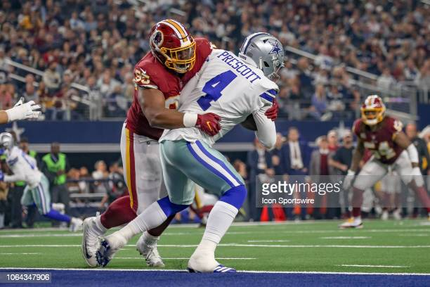 Dallas Cowboys Quarterback Dak Prescott is sacked on the goal line by Washington Redskins Nose Tackle Da'Ron Payne during the Thanksgiving Day game...