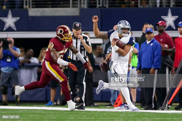 Dallas Cowboys quarterback Dak Prescott is shoved out of bounds by Washington Redskins linebacker Zach Brown during the Thursday Night Football game...