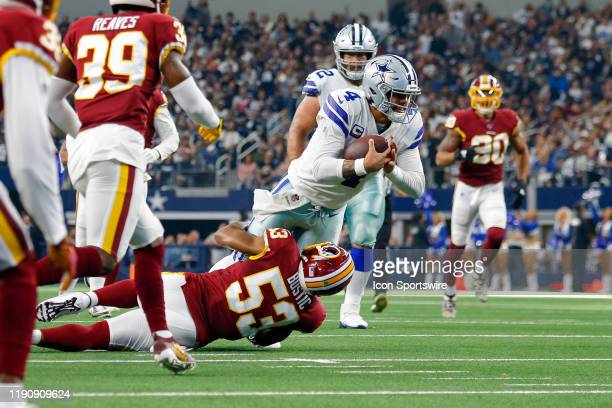 Dallas Cowboys Quarterback Dak Prescott is stopped short of a first down by Washington Redskins Linebacker Jon Bostic during the NFC East game...