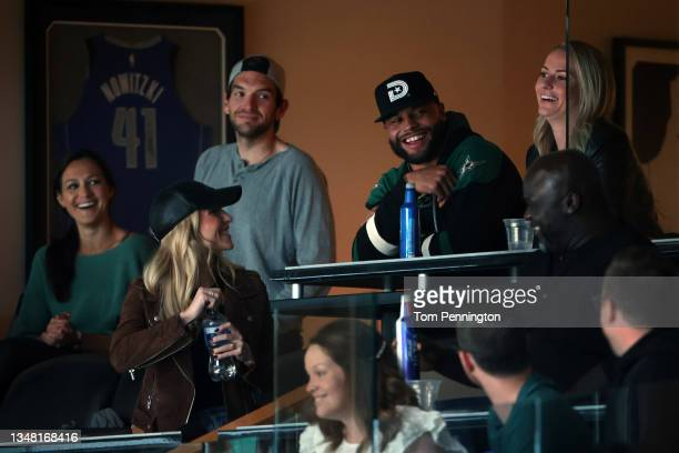 Dallas Cowboys quarterback Dak Prescott laughs with friends as the Dallas Stars take on the Los Angeles Kings in the third period at American...