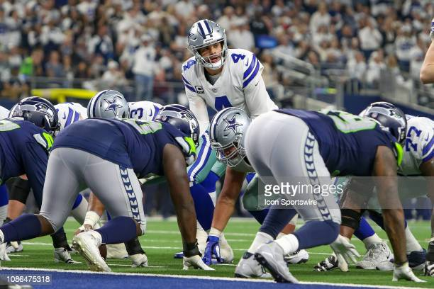 Dallas Cowboys quarterback Dak Prescott looks over the line during the NFC wildcard playoff game between the Seattle Seahawks and Dallas Cowboys on...