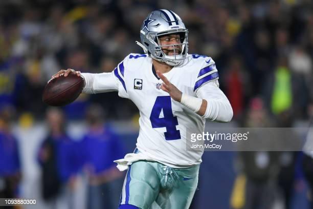 Dallas Cowboys quarterback Dak Prescott rolls out against the Los Angeles Rams at Los Angeles Memorial Coliseum on January 12 2019 in Los Angeles...