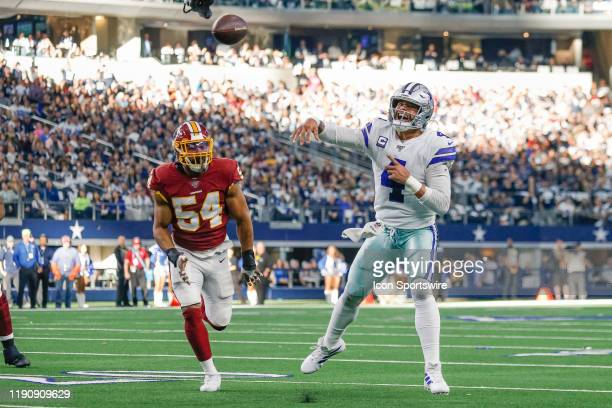 Dallas Cowboys Quarterback Dak Prescott rolls out and throws a touchdown pass during the NFC East game between the Dallas Cowboys and Washington...