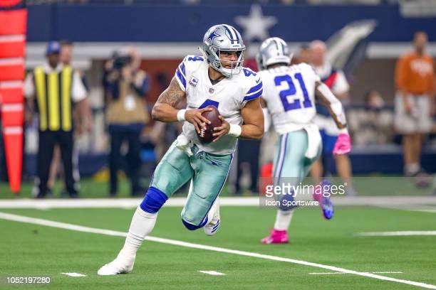 Dallas Cowboys quarterback Dak Prescott rolls out during the game between the Jacksonville Jaguars and Dallas Cowboys on October 14 2018 at ATT...