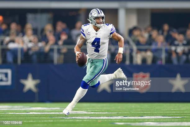 Dallas Cowboys quarterback Dak Prescott rolls out to his right during the game between the Jacksonville Jaguars and Dallas Cowboys on October 14 2018...