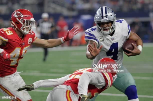 Dallas Cowboys quarterback Dak Prescott runs on a designed play pursued by Kansas City Chiefs safety Daniel Sorensen and cornerback Kenneth Acker in...
