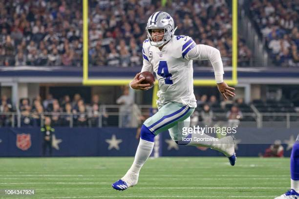 Dallas Cowboys Quarterback Dak Prescott runs with the ball during the Thanksgiving Day game between the Washington Redskins and Dallas Cowboys on...