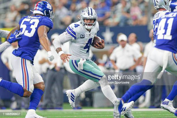 Dallas Cowboys Quarterback Dak Prescott rushes for a first down during the game between the New York Giants and the Dallas Cowboys on September 8...