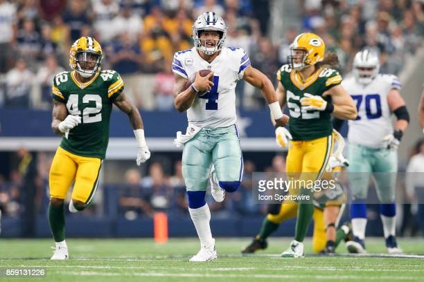 Dallas Cowboys quarterback Dak Prescott rushes for a first down during the football game between the Green Bay Packers and Dallas Cowboys on October...