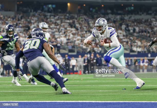 Dallas Cowboys quarterback Dak Prescott rushes to the goal line during the NFC wildcard playoff game between the Seattle Seahawks and Dallas Cowboys...
