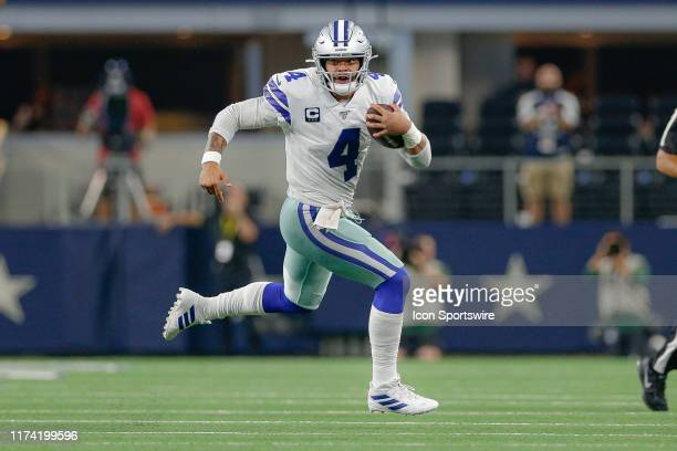 Dallas Cowboys quarterback Dak Prescott rushes with the ball during the game between the Green Bay Packers and Dallas Cowboys on October 6, 2019 at...