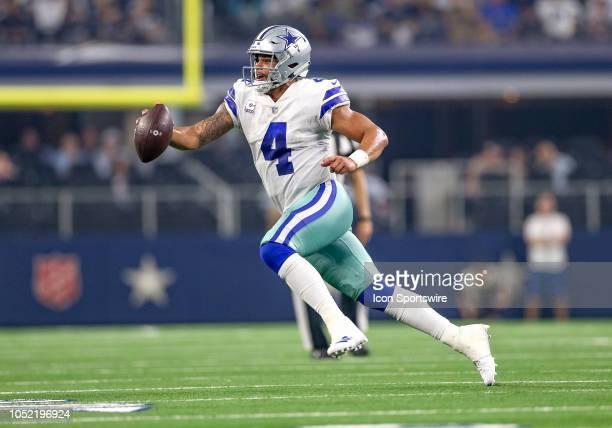 Dallas Cowboys quarterback Dak Prescott scrambles during the game between the Jacksonville Jaguars and Dallas Cowboys on October 14 2018 at ATT...