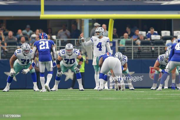 Dallas Cowboys Quarterback Dak Prescott signals at the line of scrimmage during the game between the New York Giants and the Dallas Cowboys on...