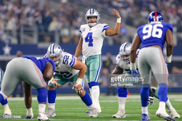 Dallas Cowboys quarterback Dak Prescott signals during the game between the New York Giants and Dallas Cowboys on September 16 2018 at ATT Stadium in...
