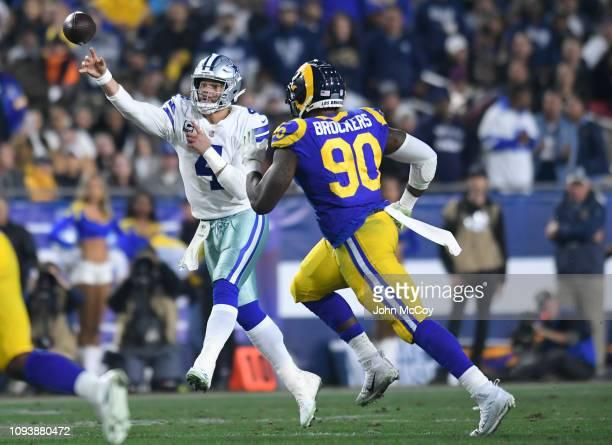 Dallas Cowboys quarterback Dak Prescott thows the ball against Los Angeles Rams defensive end Michael Brockers at Los Angeles Memorial Coliseum on...