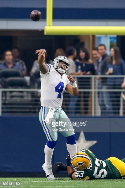 Dallas Cowboys quarterback Dak Prescott throws a deep pass while pressured by Green Bay Packers outside linebacker Nick Perry during the football...